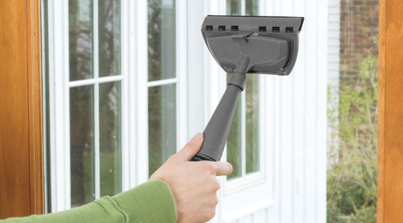 cleaning windows with a steam cleaner